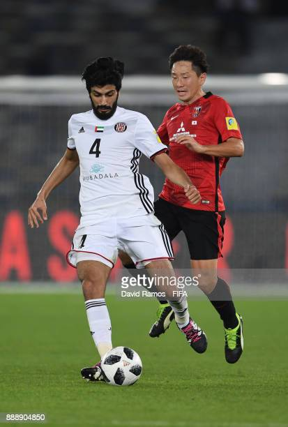 Mohammed Ayed of AlJazira and Tomoya Ugajin of Urawa Red Diamonds in action during the FIFA Club World Cup match between Al Jazira and Urawa Red...