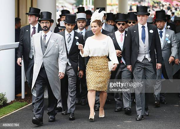 Mohammed bin Rashid Al Maktoum and Princess Haya bint Al Hussein attend day four of Royal Ascot 2014 at Ascot Racecourse on June 20 2014 in Ascot...