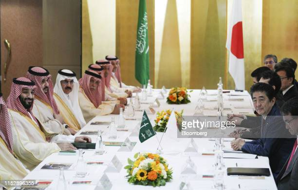 Mohammed bin Salman Saudi Arabia's crown prince left and Shinzo Abe Japan's prime minister second right attend a bilateral meeting on the sidelines...