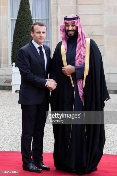 Mohammed bin Salman Saudi Arabia's crown prince right and Emmanuel Macron France's president pose for photographers ahead of their meeting in Paris...