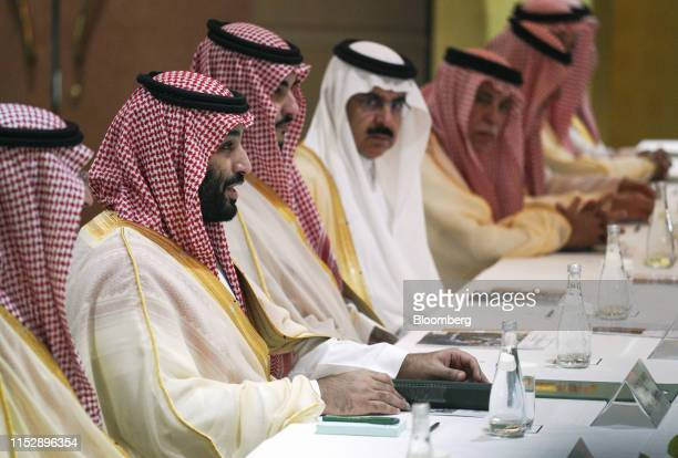 Mohammed bin Salman Saudi Arabia's crown prince second left speaks during a bilateral meeting with Shinzo Abe Japan's prime minister not pictured on...