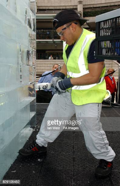 Mohammed Bouzroud successfully pulls a bottle from a 10tonnes ice cube at Broadgate Arena near London's Liverpool Street Station The 25 squaremetre...