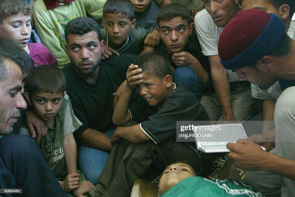 Mohammed, brother of Mahmud Mansur, weeps during the latter's funeral at Al-Abrar mosque in the southern Gaza Strip town of Rafah 20 May 2004. Mansur, 12, is one of at least 10 Palestinians killed as a demonstration came under Israeli army fire yesterday in Rafah's Tal al-Sultan neighbourhood. AFP PHOTO/Mauricio LIMA