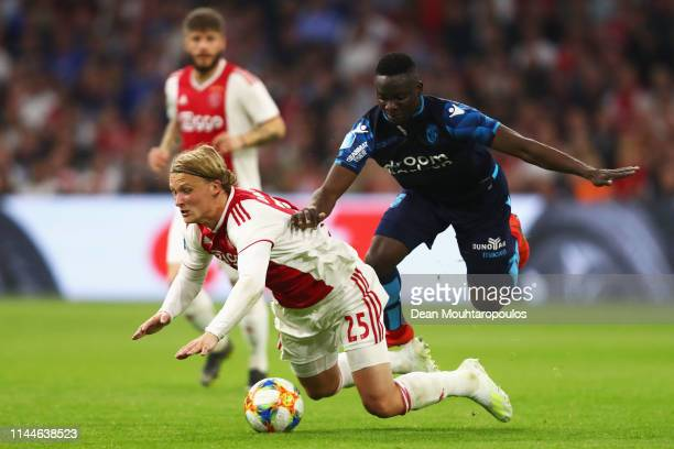 Mohammed Dauda of Vitesse tackles and fouls Kasper Dolberg of Ajax during the Eredivisie match between Ajax and Vitesse at Johan Cruyff Arena on...