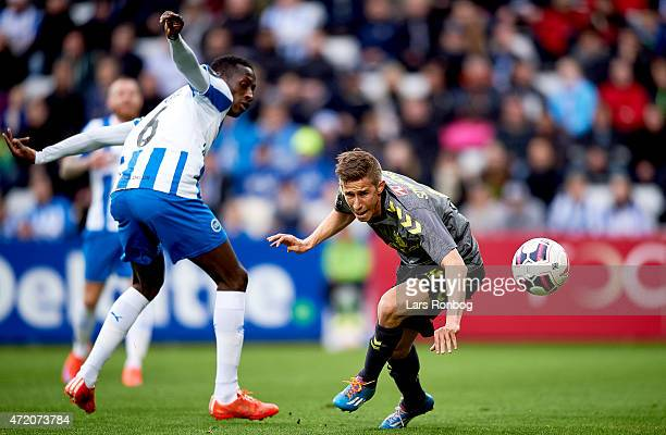 Mohammed Diarra of OB Odense and Alexander Szymanowski of Brondby IF compete for the ball during the Danish Alka Superliga match between OB Odense...