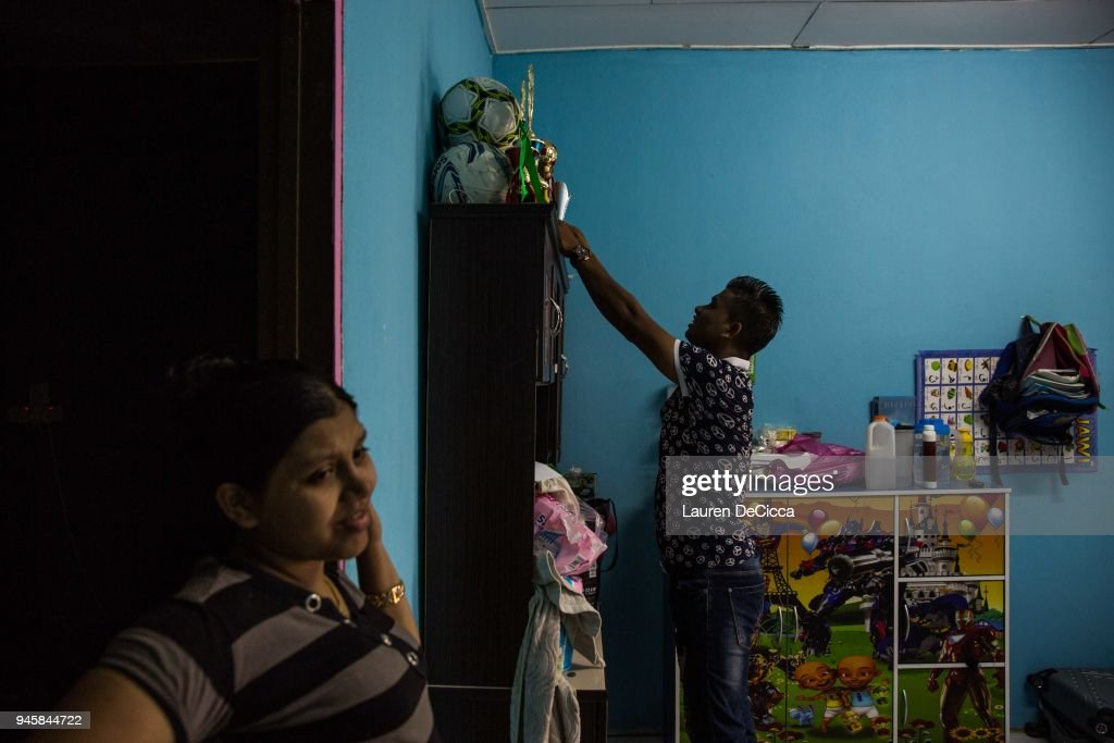 Mohammed Eoris arranges his football trophies in his family's kitchen on April 12, 2018 in Kulim, Malaysia. Mohammed Eoris is a football player for the Kedah Kulim Rohingya Football Club. The aim of the club is to build community and raise awareness for the Rohingya crisis throughout the region. A group of Rohingya refugees from Myanmar's Rakhine State formed the Rohingya Football Club in Malaysia back in 2015, hoping to give the Rohingya people a voice through sports and raise their international profile amidst the crisis in the region. Rohingya Muslims are reportedly playing in Football Clubs around the world, including Canada, Australia, and Ireland, while the Rohingya F.C. aims to set up a national team which comprises of these players and show that Rakhine Muslims can succeed in the sport. The United Nations estimate that over 62 thousand Rohingya are currently living in Malaysia and most of them are only able to find jobs as a construction worker or laborer with many staying in makeshift homes near construction sites. Malaysia launched its first Rohingya tournament this year with 24 independent football clubs competing across the Muslim country, hoping to gather support from the Malaysian and Turkish governments to help them succeed at an international level. Over 700,000 Muslim Rohingya have crossed the border into Bangladesh since August last year after the Myanmar military launched a brutal crackdown which was described by the United Nations as 'ethnic cleansing' while the two countries continue to negotiate the repatriation of the Rohingya refugees.