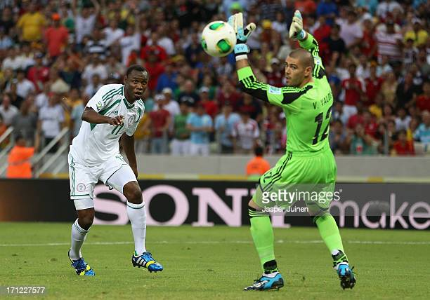 Mohammed Gambo of Nigeria misses a chance as Victor Valdes of Spain looks on during the FIFA Confederations Cup Brazil 2013 Group B match between...