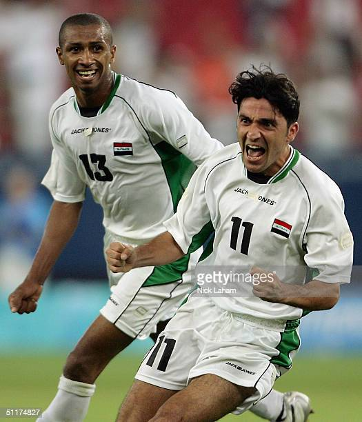 Mohammed Hawar Mulla of Iraq celebrates scoring Iraq's first goal during the men's football preliminary match on August 15, 2004 during the Athens...