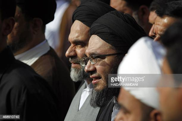 Mohammed Hussein and Mohammed Rida , sons of Iraq's top Shiite cleric Grand Ayatollah Ali al-Sistani, attend the funeral of Shiite Muslim cleric...
