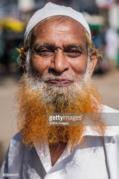 COX'S BAZAR SEA BEACH COX'S BAZAR BANGLADESH Mohammed is a street vendor here seen posing for a photo with his henna stained beard a popular way of...
