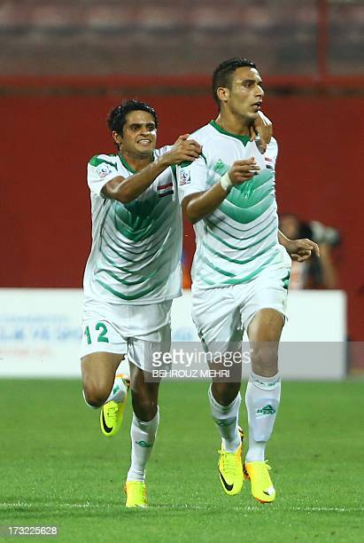 Mohammed Jabbar Arebat and Ali Adnan of Iraq celebrate after scoring a goal against Uruguay during their SemiFinal football match at the FIFA Under...