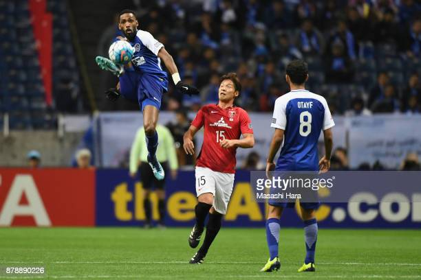 Mohammed Jahfali of AlHilal clears the ball in front of Kazuki Nagasawa of Urawa Red Diamonds during the AFC Champions League Final second leg match...