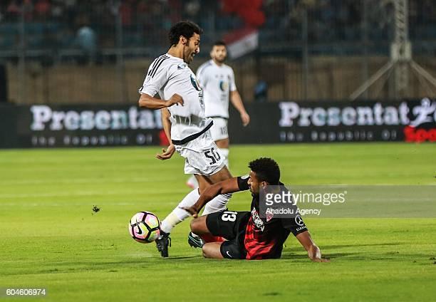 Mohammed Jamal of Al Ahli Dubai is in action against Khamis Esmaeel Zayed of Al Jazira during the Arabian Gulf Super Cup match between United Arab...