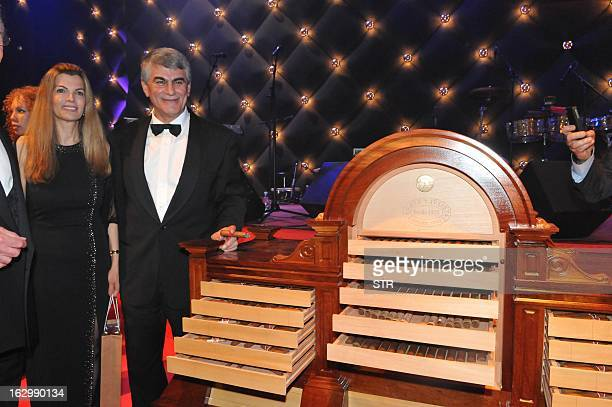 Mohammed Mohebi from Mohebi Investments of Dubai poses near a humidifier for cigars he acquired during the gala dinner for the XV Cigar Festival in...