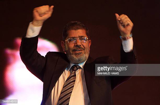 Mohammed Mursi, the Muslim Brotherhood's candidate in Egypt's presidential election, waves to his supporters during a campaign rally in Cairo on May...
