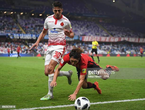 Mohammed Nahiri of Wydad Casablanca and Tsukasa Umesaki of Urawa Reds in action during the FIFA Club World Cup UAE 2017 fifth place playoff match...