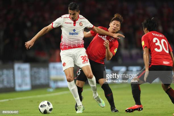 Mohammed Nahiri of Wydad Casablanca competes with Kazuki Nagasawa of Urawa Red Diamonds during the FIFA Club World Cup UAE 2017 fifth place playoff...
