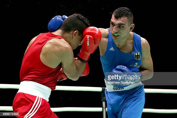 Mohammed Rabii of Moracco fights Arajik Marut Jan of Germany in the Men's Welter class during the International Boxing Tournament Aquece Rio Test...