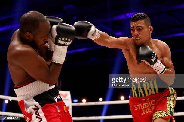 Mohammed Rabii of Morocco and Jean Pierre Habimana of Belgium exchange punches during their super welterweight fight at Messehalle Erfurt on April 22...