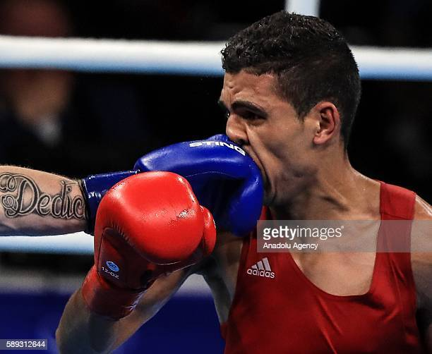 Mohammed Rabii of Morocco fights Gerard Steven Donelly of Ireland during the Men's 69 kg bout of the Rio 2016 Olympic Games on August 13 2016 in Rio...