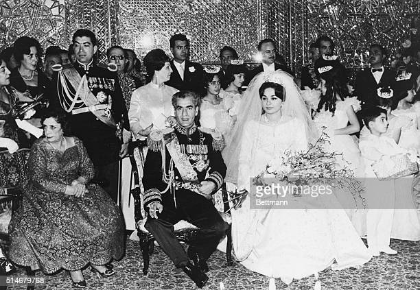 Mohammed Reza Pahlavi the Shah of Iran has just married his third wife Farah Diba The Shah's mother is seated left of him with his brother Golem...