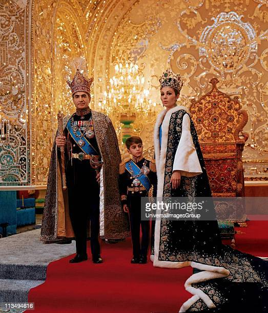 Mohammed Reza Shah Pahlavi Shah of Iran 19411979 with his third wife Farah Diba and their son Reza in ceremonial dress in front of throne