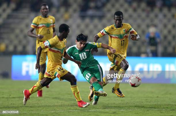Mohammed Ridhaiq of Iraq takes a shot at goal under pressure from Mamdou Samake and Ibrahim Kane of Mali during the FIFA U17 World Cup India 2017...