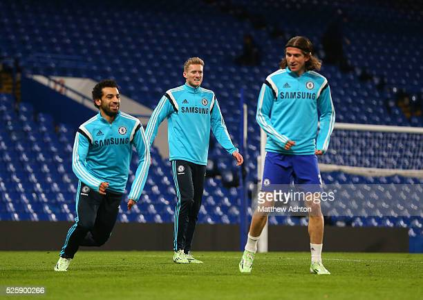 Mohammed Salah Andre Schurrle and Filipe Luis of Chelsea warm down at the the end of the match