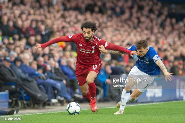 Mohammed Salah of Liverpool beats Lucas Digne of Everton FC during the Premier League match between Everton and Liverpool at Goodison Park Liverpool...