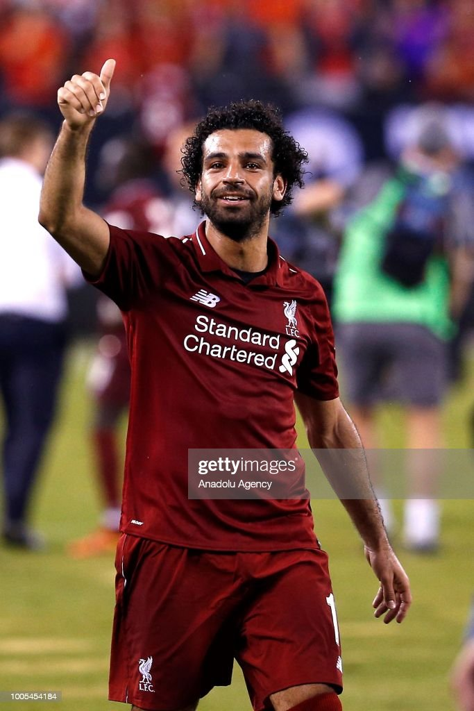 Mohammed Salah of Liverpool salutes to the fans at the end of a friendly match between Manchester City and Liverpool FC within the International Champions Cup at MetLife Stadium in New Jersey, United States on July 25, 2018.