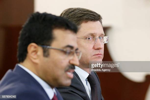 Mohammed Saleh Al Sada Minister of Energy and Industry of Qatar is seen with Russia's Energy Minister Alexander Novak during a joint press conferance...