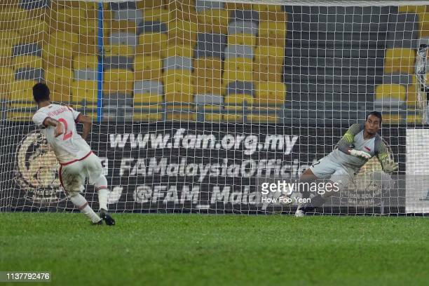 Mohammed Saleh Ali of Oman in action during penalty shootout with Zairul Nizam of Singapore during the Airmarine Cup final between Singapore and Oman...