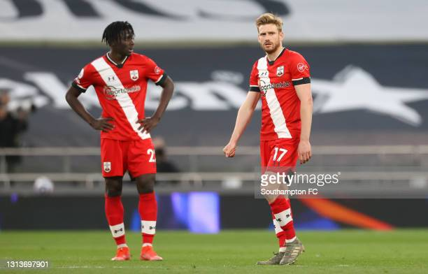 Mohammed Salisu and Stuart Armstrong of Southampton react to defeat after the Premier League match between Tottenham Hotspur and Southampton at...