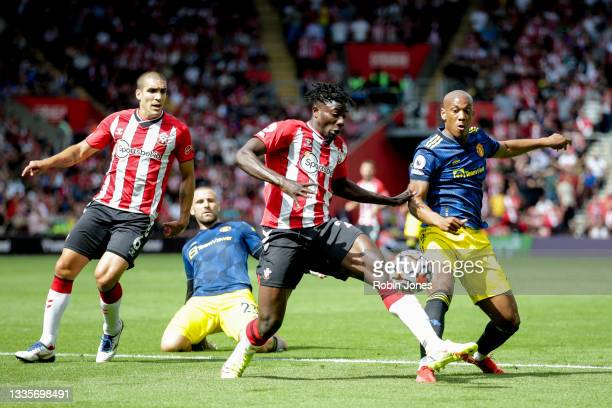 Mohammed Salisu of Southampton clears from Anthony Martial of Manchester United during the Premier League match between Southampton and Manchester...