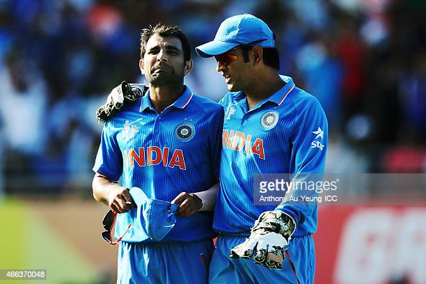 Mohammed Shami and MS Dhoni of India talk during the 2015 ICC Cricket World Cup match between India and Zimbabwe at Eden Park on March 14 2015 in...
