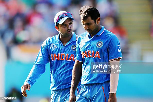 Mohammed Shami and Suresh Raina of India talk during the 2015 ICC Cricket World Cup match between India and Zimbabwe at Eden Park on March 14 2015 in...