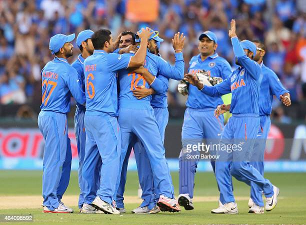 Mohammed Shami and Virat Kohli of India are congratulated after dismissing Quinton de Kock of South Africa during the 2015 ICC Cricket World Cup...