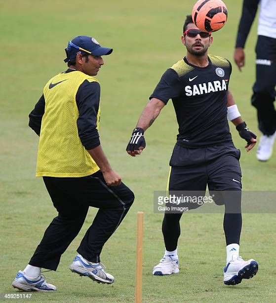 Mohammed Shami and Virat Kohli of India play football during the Indian national cricket team training session and press conference at Sahara Stadium...