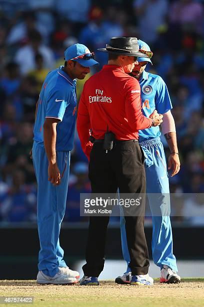Mohammed Shami and Virat Kohli of India speak to umpire Richard Kettleborough about the ballduring the 2015 Cricket World Cup Semi Final match...