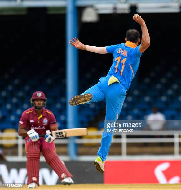 Mohammed Shami of India attempts to run out Nicholas Pooran of West Indies during the 3rd ODI match between West Indies and India at Queens Park...