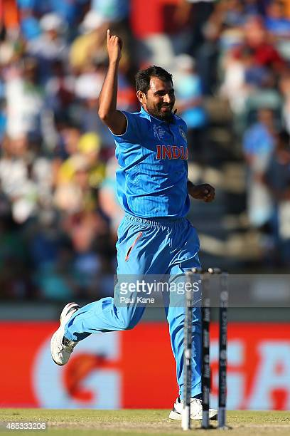 Mohammed Shami of India celebrates after dismissing Darren Sammy of the West Indies during the 2015 ICC Cricket World Cup match between India and the...