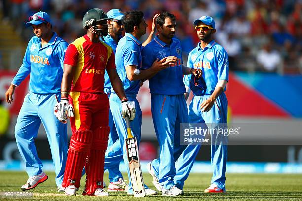 Mohammed Shami of India celebrates his wicket of Sikandar Raza of Zimbabwe during the 2015 ICC Cricket World Cup match between India and Zimbabwe at...