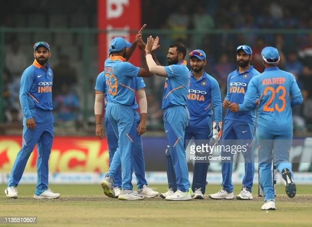 Mohammed Shami of India celebrates taking the wicket of Alex Carey of Australia during game five of the One Day International series between India...