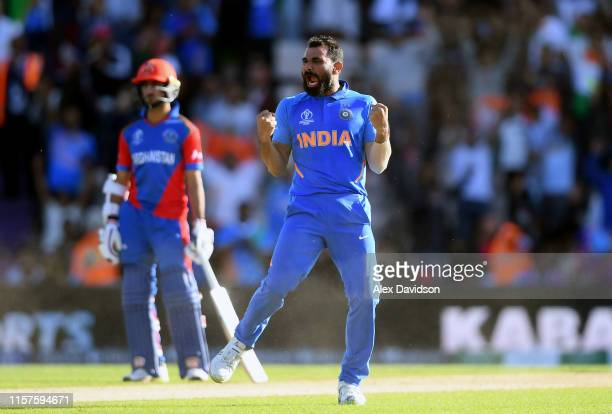 Mohammed Shami of India celebrates the wicket of Mujeeb Ur Rahman of Afghanistan, his hat-rick and victory during the Group Stage match of the ICC...