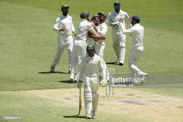 Mohammed Shami of India celebrates the wicket of Usman Khawaja of Australia during day four of the second match in the Test series between Australia...