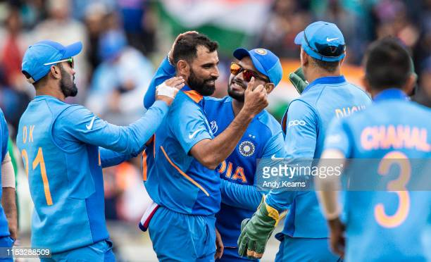 Mohammed Shami of India celebrates with his team mates on taking the wicket of Tamim Iqbal of Bangladesh during the Group Stage match of the ICC...