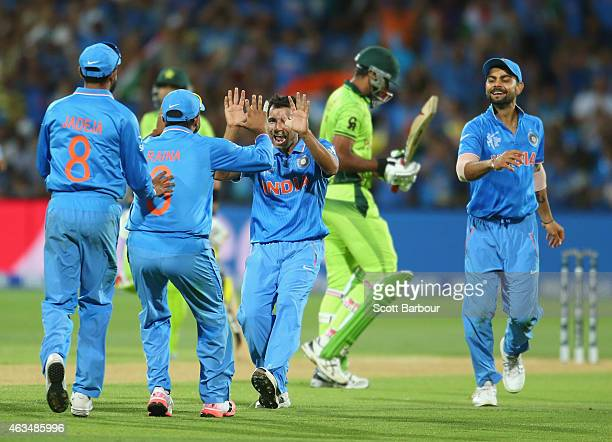 Mohammed Shami of India celebrates with his teammates after dismissing Wahab Riaz of Pakistan during the 2015 ICC Cricket World Cup match between...