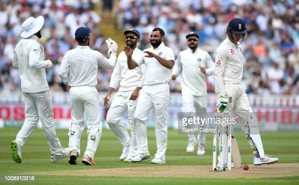 Mohammed Shami of India celebrates with teammates after dismissing Keaton Jennings of England during the Specsavers 1st Test between England and...