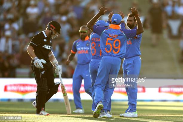 Mohammed Shami of India celebrates with the team after dismissing Kane Williamson of the Black Caps during game two of the One Day International...