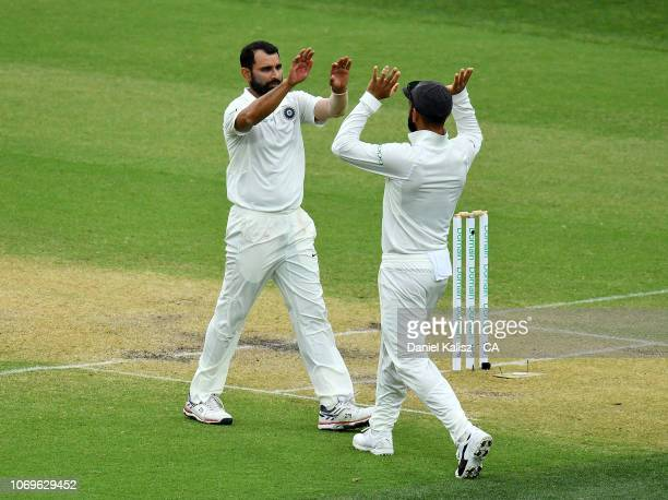 Mohammed Shami of India celebrates with Virat Kohli of India during day three of the First Test match in the series between Australia and India at...
